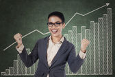 Happy winning businesswoman with arms up — Stock Photo