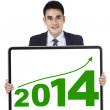 Young businessman showing the new year 2014 — Stock Photo