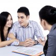 Young couple meeting financial consultant — Stock Photo