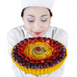 Young woman chef with fruit cake — Stock Photo