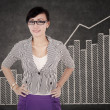 Smiling businesswoman with growth graph — Stock Photo