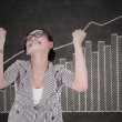 Happy businesswoman with growth graph — Stock Photo