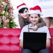 Christmas online shopping at home — Stock Photo #35026519