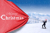 Asian businesswoman pull christmas banner — Stockfoto