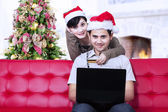 Christmas online shopping at home — Stock Photo