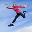 Pretty woman jumping in wintertime — Stock Photo