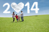 Happy family celebrate new year of 2014 — Stock Photo