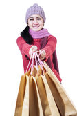 Winter woman with shopping bags — Stok fotoğraf