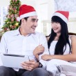 Stock Photo: Happy couple using digital tablet
