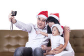 Christmas family take a photo — Stock Photo