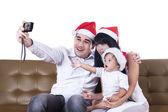 Christmas family take a photo — Stock Photo