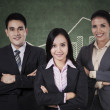 Confident businessteam with graph — Stock Photo #35875031
