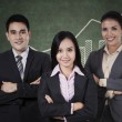 Confident businessteam with graph — Stock Photo