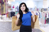 Beautiful woman in shopping centre — Stock Photo