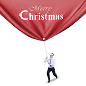 Businessman pulls christmas banner — Photo