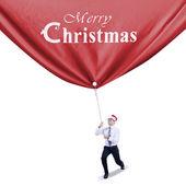 Businessman pulls christmas banner — Stock Photo