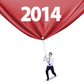 Businessman pulls new year banner — Stock Photo