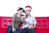Christmas couple watching TV — Stock Photo
