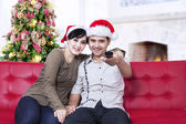 Happy christmas couple at home — Stock Photo
