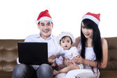 Happy family with notebook — Stock Photo