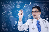 Male doctor is writing on digital screen — Stock Photo