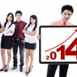 Business people showing the new year 2014 — Stock Photo