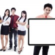 Business team showing empty banner — Stock Photo
