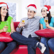 Group of friends celebrating a christmas eve — Foto de Stock