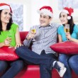 Group of friends celebrating a christmas eve — Foto Stock