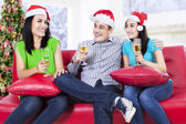 Group of friends celebrating a christmas eve — Stock Photo