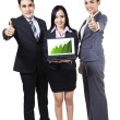 Business people showing graph on laptop — Stok fotoğraf