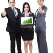 Business people showing graph on laptop — Stockfoto