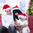 Happy family using tablet computer — Stock Photo