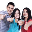 Happy friends giving thumbs up — Stock Photo