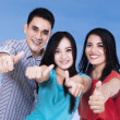 Stock Photo: Joyful friends giving thumbs up