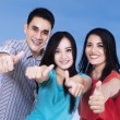 Joyful friends giving thumbs up — Stock Photo