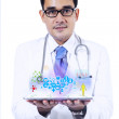 Male doctor holding a tablet — Stock Photo #36476725