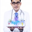 Male doctor holding a tablet — Stock Photo
