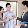 The agent handed the keys to young couple — Stock Photo #36478043
