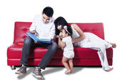 Asian family reading story — Stock Photo