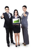 Business people showing graph on laptop — Stock Photo