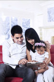 Family holding a digital tablet — Stock Photo