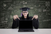 Graduate student showing copyspace on laptop — Stock Photo
