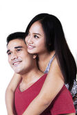 Isolated smiling young couple — Photo