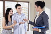 The agent handed the keys to young couple — Stock Photo