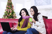 Two happy women using a laptop — Stock Photo