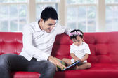 Young father reading story book with his baby — Stock Photo