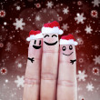 Happy finger smileys in Santa hats — Stock Photo