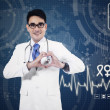 Medical doctor showing heart sign — Stock Photo