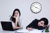 Team of two tired businesswoman — Stock Photo